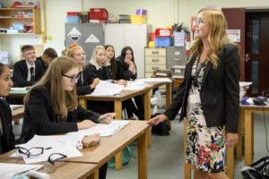 Teacher standing infront of classroom